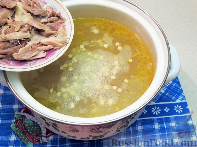 Фото приготовления рецепта: Куриный суп с овсяными хлопьями - шаг №11