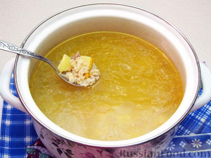 Фото приготовления рецепта: Куриный суп с овсяными хлопьями - шаг №12