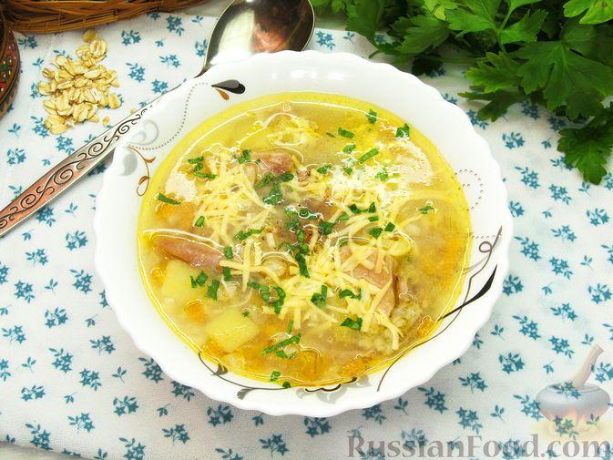 Фото приготовления рецепта: Куриный суп с овсяными хлопьями - шаг №14