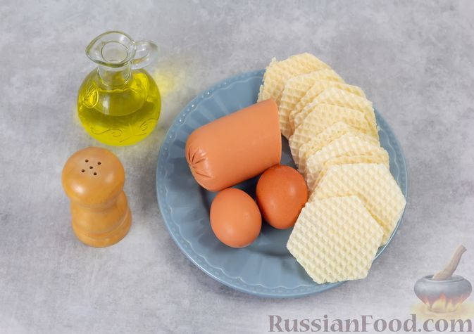 Фото приготовления рецепта: Колбаса, обжаренная в вафельных коржах - шаг №1