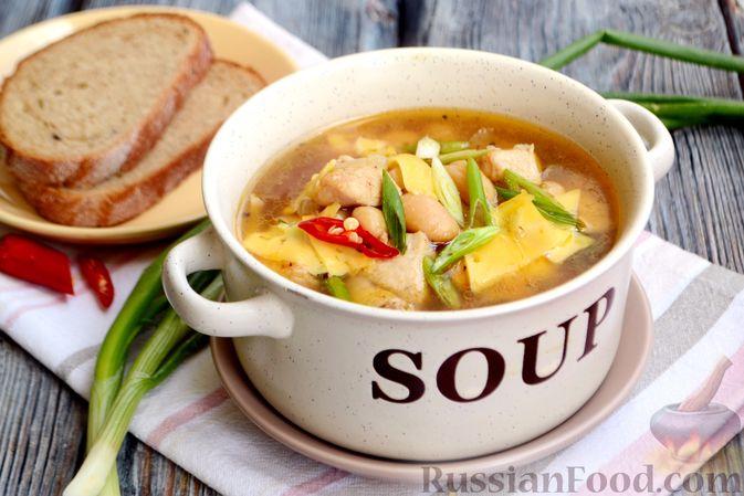 Фото приготовления рецепта: Пряный суп с куриным филе и консервированной фасолью - шаг №16