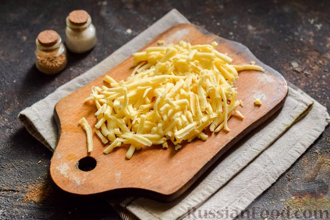 Фото приготовления рецепта: Кабачки, запечённые с молодой картошкой и помидорами, в соусе бешамель - шаг №17