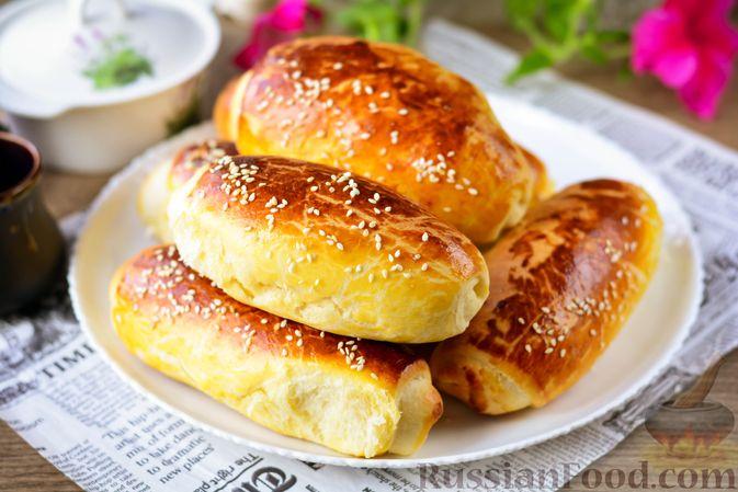 Фото приготовления рецепта: Дрожжевые булочки с кунжутом - шаг №19
