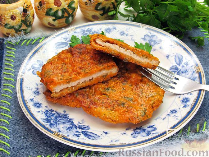 Фото к рецепту: Отбивные из свинины в томатно-сырном кляре
