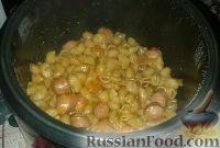 Фото к рецепту: Макароны с сосисками в мультиварке