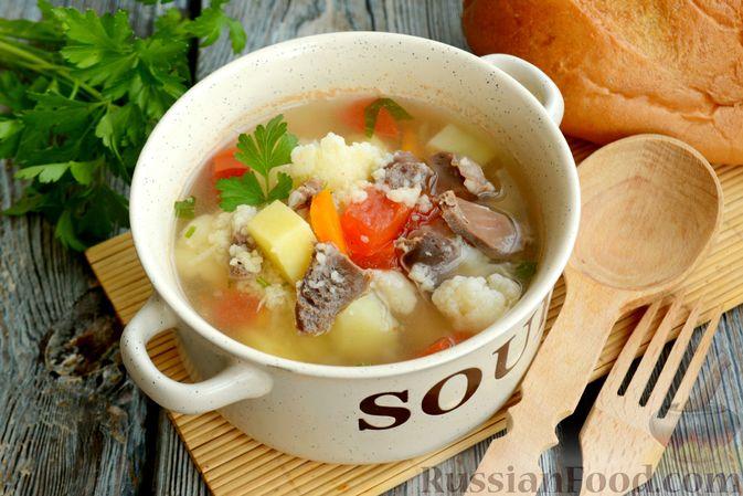 Фото к рецепту: Суп с куриными желудками, цветной капустой и кускусом