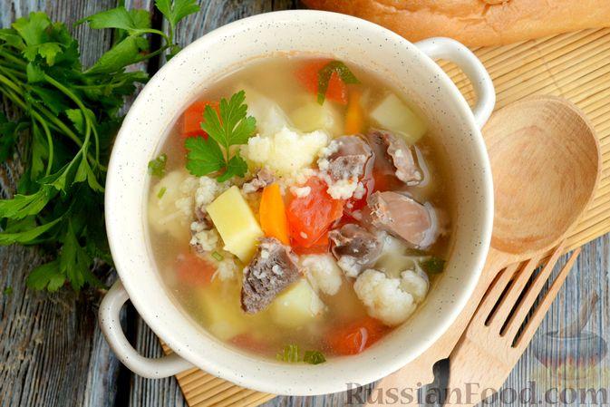 Фото приготовления рецепта: Суп с куриными желудками, цветной капустой и кускусом - шаг №13