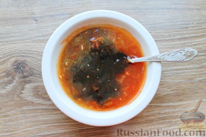 Фото приготовления рецепта: Шашлык из куриных сердечек в маринаде из соевого соуса и апельсинового сока (в духовке) - шаг №9