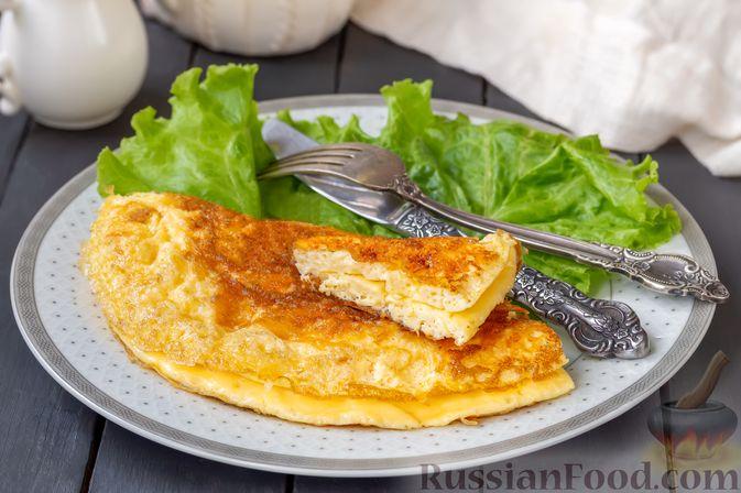 Фото приготовления рецепта: Омлет с сырной корочкой - шаг №7