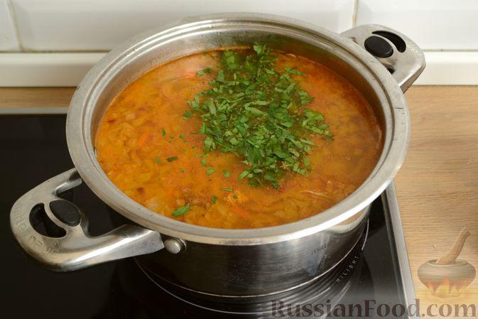 Фото приготовления рецепта: Куриный суп с помидорами и рисом - шаг №16
