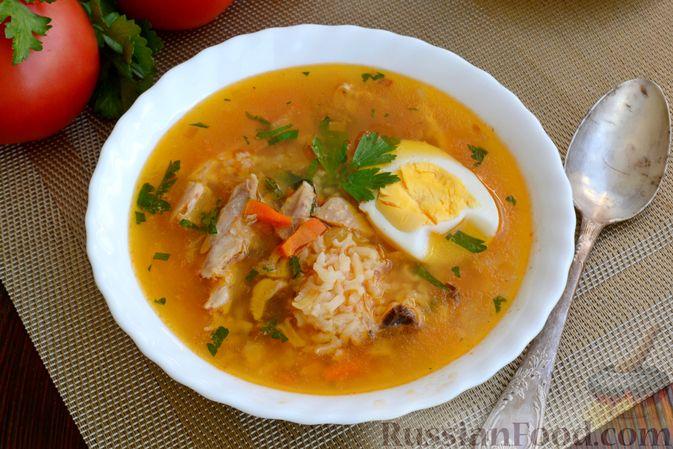 Фото приготовления рецепта: Куриный суп с помидорами и рисом - шаг №18