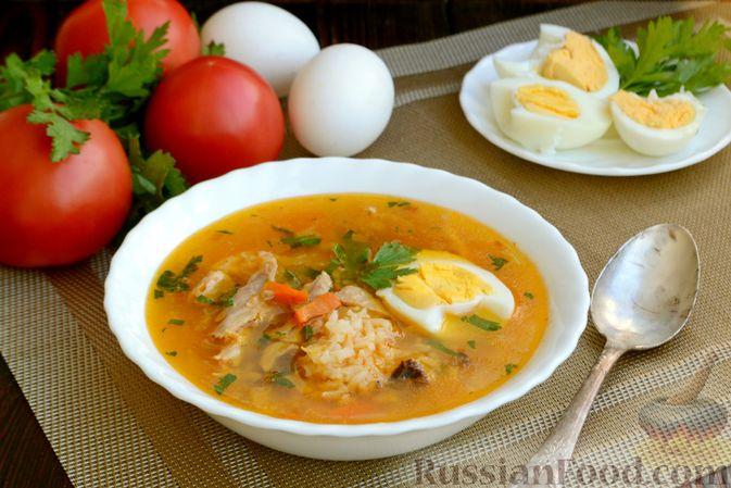 Фото приготовления рецепта: Куриный суп с помидорами и рисом - шаг №19