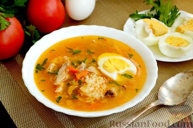 Фото к рецепту: Куриный суп с помидорами и рисом