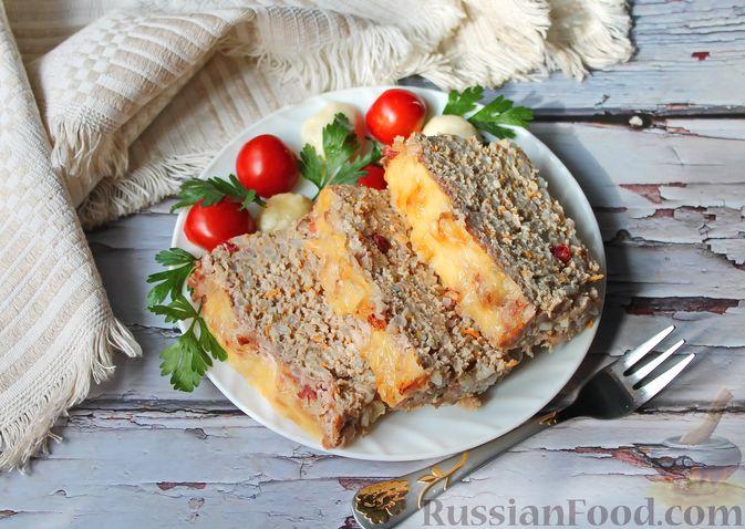 Фото к рецепту: Запеканка из свиного фарша с кабачками, рисом и брусникой
