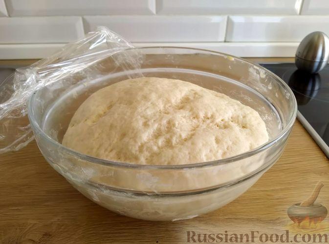 Фото приготовления рецепта: Пшеничный хлеб на кефире - шаг №7