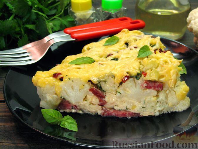 Фото к рецепту: Запеканка из цветной капусты с колбасой и сыром