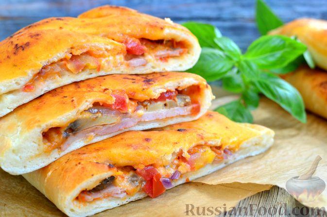 Фото к рецепту: Закрытые пиццы с ветчиной и грибами