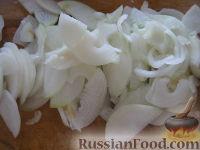 Фото приготовления рецепта: Салат «Нежинский» из огурцов на зиму - шаг №4