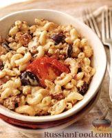 Фото к рецепту: Макароны, запеченные с оливками и мясом под сырным соусом