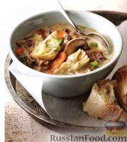 Фото к рецепту: Сливочный суп с грибами и артишоками