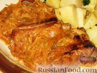 Фото к рецепту: Свиные ребра, тушенные с капустой