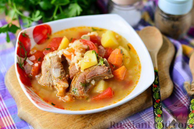 Фото к рецепту: Суп с говяжьими рёбрами, рисом и помидорами