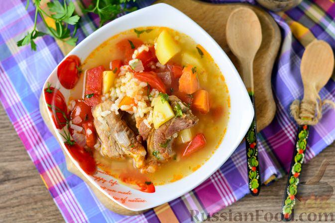 Фото приготовления рецепта: Суп с говяжьими рёбрами, рисом и помидорами - шаг №14