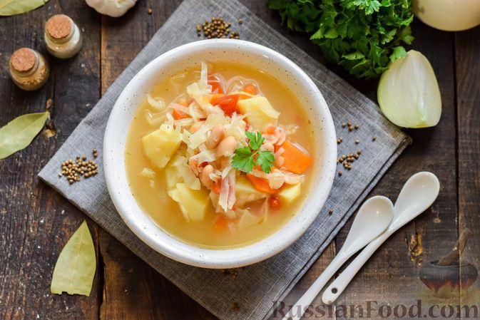 Фото приготовления рецепта: Овощной суп с фасолью и капустой - шаг №13