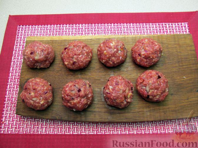 Фото приготовления рецепта: Мясные тефтели в томатно-тыквенным соусе - шаг №21