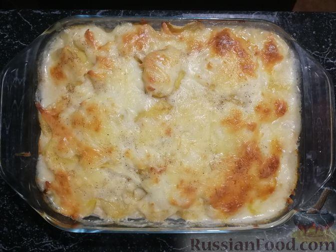 Фото приготовления рецепта: Картофельная запеканка с ветчиной, сыром и соусом бешамель - шаг №13