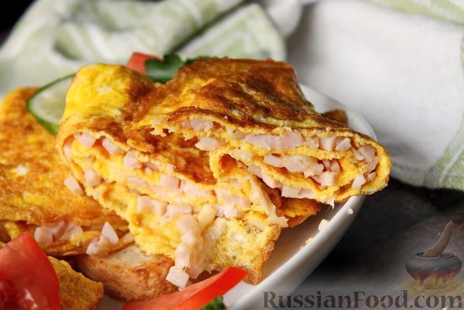 Фото приготовления рецепта: Бутерброды с яичными блинчиками, ветчиной и сыром - шаг №15
