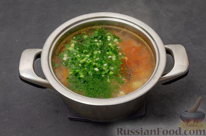 Фото приготовления рецепта: Куриный суп с картофелем - шаг №10
