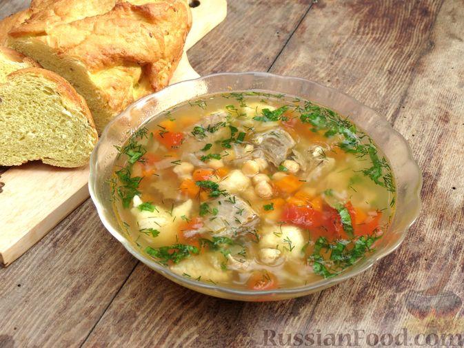 Фото приготовления рецепта: Говяжий суп с нутом, клёцками и помидорами - шаг №16
