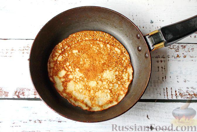 Фото приготовления рецепта: Дрожжевые блины на молоке - шаг №14