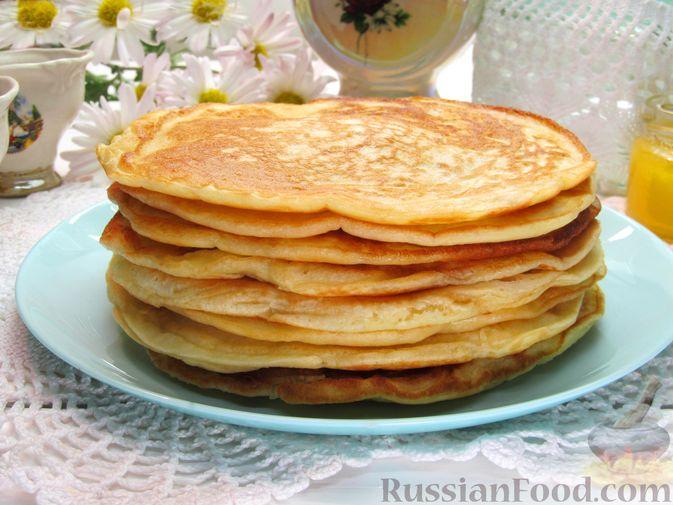 Фото приготовления рецепта: Толстые дрожжевые блины на молоке - шаг №14