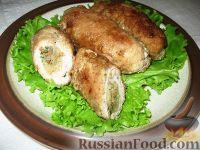 Фото к рецепту: Свиные рулеты с капустой и лисичками