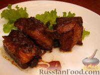 Фото к рецепту: Свиные ребрышки в маринаде из меда и соевого соуса