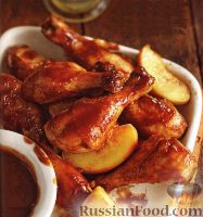 Фото к рецепту: Куриные крылышки  (в медленноварке)