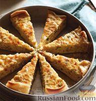 Фото к рецепту: Луковый пирог с сыром