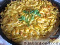 Фото к рецепту: Куриные бедрышки с картофелем, запеченные в духовке