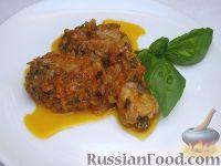 Фото к рецепту: Свиные ребрышки, тушенные с томатным соком
