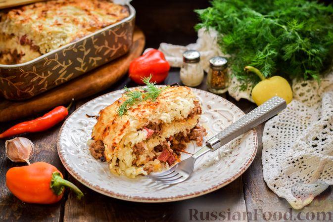 Фото к рецепту: Запеканка из квашеной капусты, мясного фарша и риса