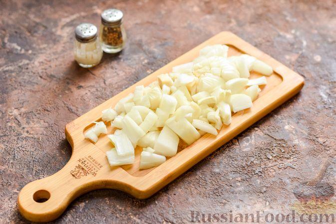 Фото приготовления рецепта: Запеканка из квашеной капусты, мясного фарша и риса - шаг №5