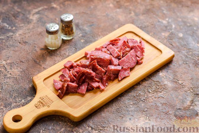 Фото приготовления рецепта: Запеканка из квашеной капусты, мясного фарша и риса - шаг №9