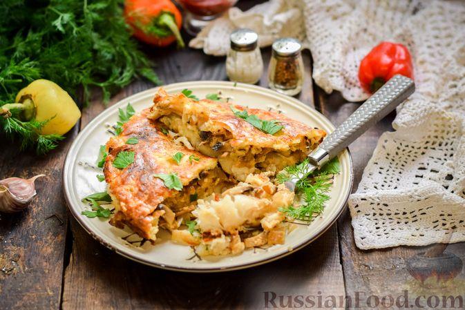Фото к рецепту: Рыбная запеканка с грибами и сметанно-сырной заливкой