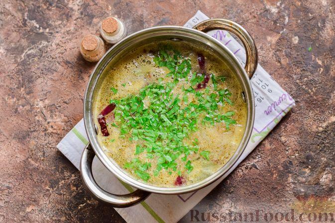 Фото приготовления рецепта: Рыбный суп из консервов, с пшеном - шаг №8