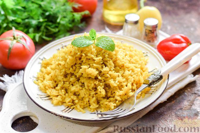 Фото приготовления рецепта: Рисовая каша на воде, с куркумой, карри и сушёными травами - шаг №6