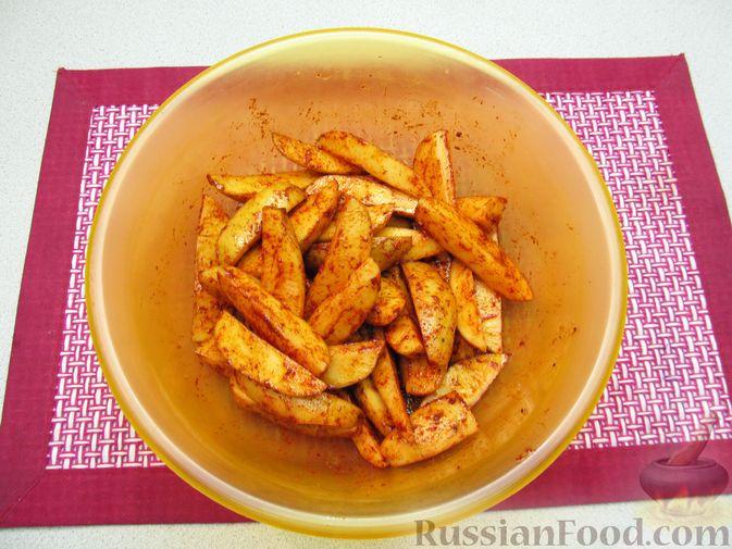 Фото приготовления рецепта: Картошка по-деревенски, в микроволновке - шаг №5