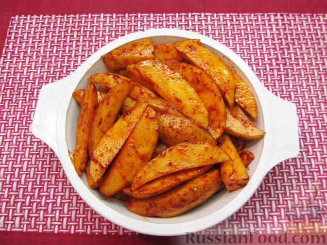 Фото приготовления рецепта: Картошка по-деревенски, в микроволновке - шаг №6
