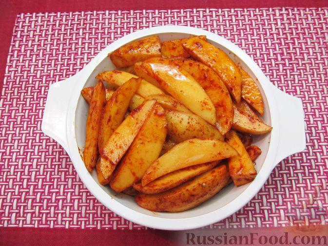 Фото приготовления рецепта: Картошка по-деревенски, в микроволновке - шаг №7